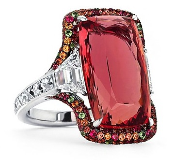 18 carat imperial topaz ring, with two step-cut trapezoid diamonds and micro-set with diamonds, sapphires, tsavorite garnets and tourmalines.