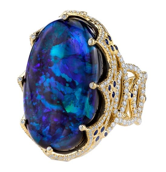 ROYAL RING 18K Yellow Gold ring featuring a 26.11 ct. Black Opal, .58 ctw. of Blue Sapphires, and 2.23 ctw. of Diamonds.