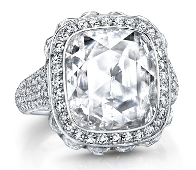 Cushion rose-cut diamond of 4.38 carats; surrounded by 12 French-cut diamonds of 2.87 carats; and micro-set with 302 brilliant round diamonds on the band. Set in platinum.