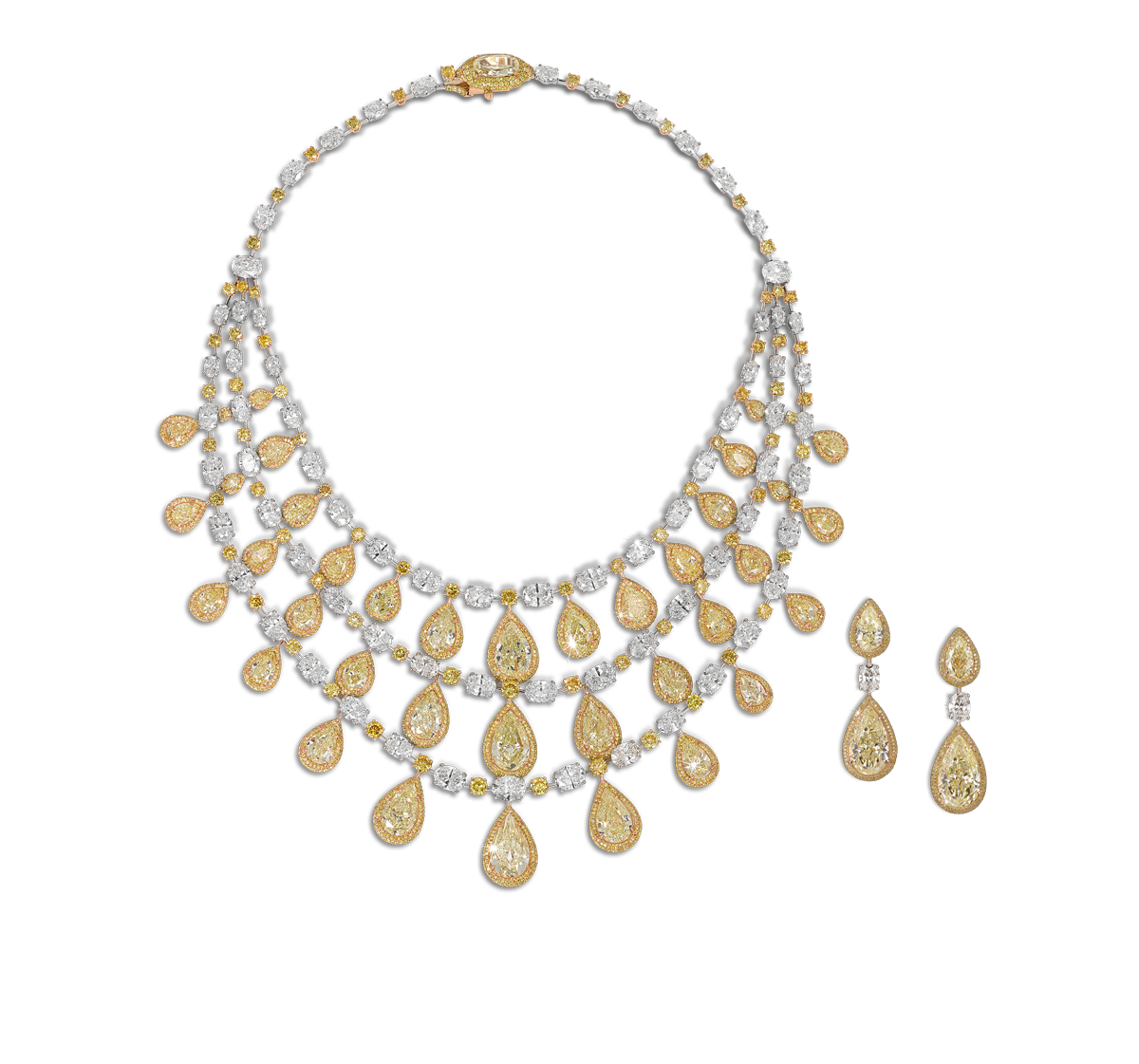 Yellow pear shape diamond necklace with white marquise and pear cut diamonds Total yellow diamond weight 105.32cts Total white diamond weight 51.54cts with matching earrings
