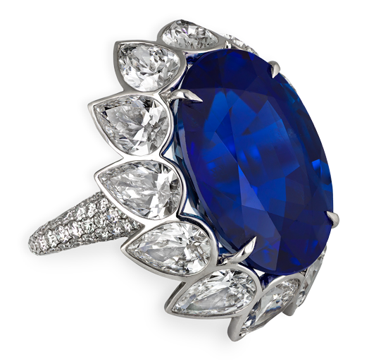 24.56ct natural Ceylon oval Sapphire mounted with pear-shape diamond surround and micro-set white diamonds Total weight 33.01cts