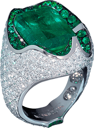 EMERALD The central stone - emerald of a rare form has an unusual tack, complicated in execution. It seems like the ring is paved with diamonds