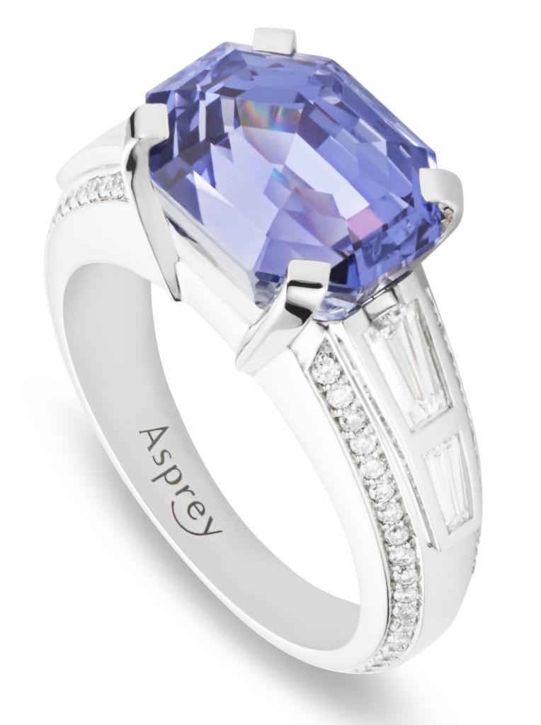 Violet sapphire surrounded by diamonds, set in platinum ring