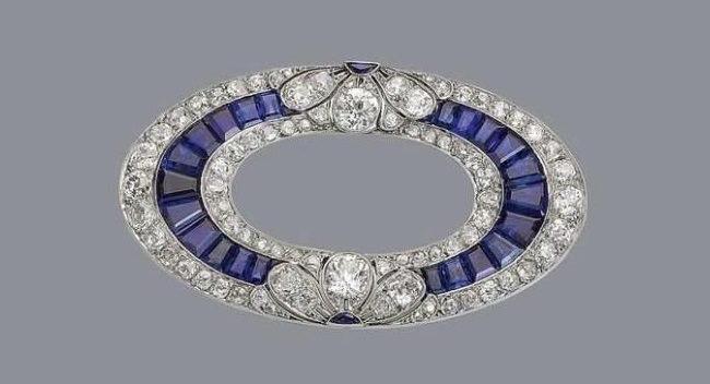 A sapphire and diamond brooch, circa 1915