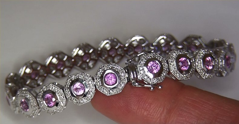"A substantial 7.18 carat estate bracelet featuing genuine VS clarity Natural Ceylon Pink Sapphires set into SOLID 14k white gold with sparkling natural accent diamonds. There are 19 bezel set round brilliant cut pink sapphires measuring approximately 3.81 mm each with a combined weight of approximately 6.16 carats. These exceptional Pink Sapphires offer VS clarity with only minor inclusions and display a rich pink color with excellent saturation and balance. Additionally, there are 304 ROUND BRILLIANT natural accent diamonds totaling and additional 1.02 carats. These Perfectly Clear diamonds are graded at Near Flawless to Eye Clean ""VS2-SI2"" clarity with NEAR COLORLESS ""G-H-I"" color so you can be assured of the superior quality, excellent brilliance, flash, sparkle & fire."