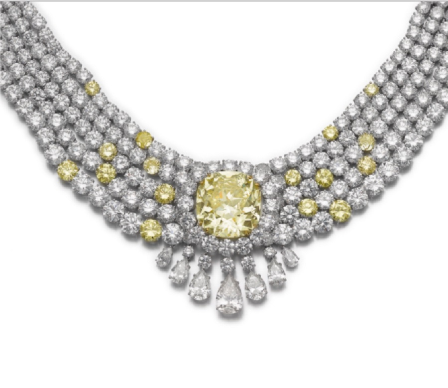 Impressive fancy intense yellow diamond and diamond necklace