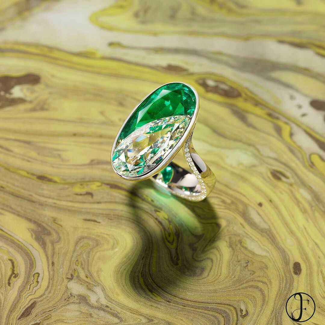 Two pear shaped gems are seamlessly set in this diamond and emerald ring creating the illusion of a perfect oval. The pear shaped Colombian no oil emerald weighs over 4 carats and is nestled against a three and half carat pear-shaped diamond.